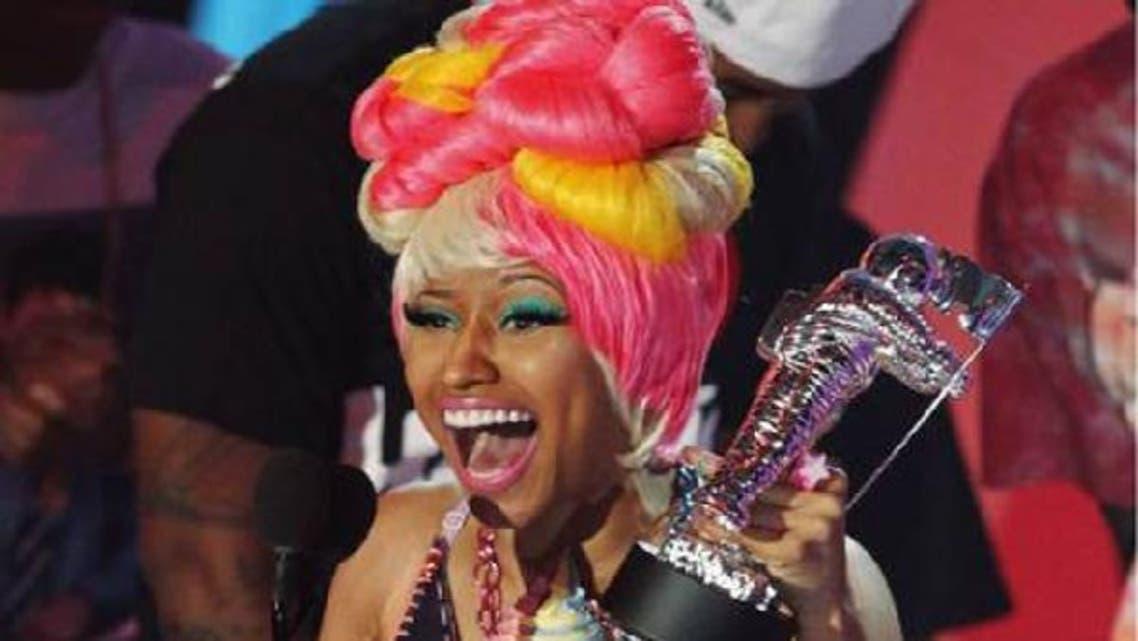 Singer Nicki Manaj poses at the 2011 MTV Video Music Awards in Los Angeles. Minaj is wearing couture by Dubai designer Furne One. (Reuters)