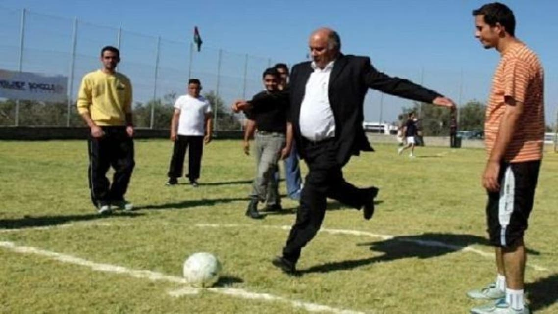 Palestinian Football Association chairman Jibril Rajoub shoots a ball during the opening ceremony of a new football field in the West Bank village of Al-Zawia. (Courtesy: Maan news agency)