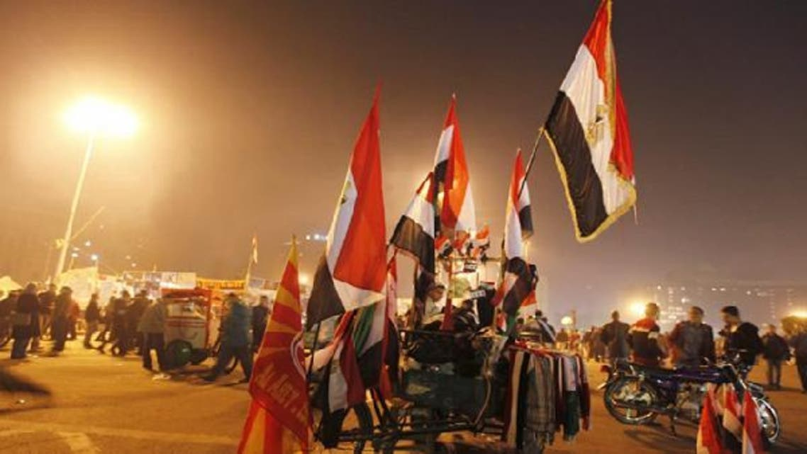 Egyptian flags are displayed for sale during New Year's Eve celebrations at Tahrir Square, where protesters opposing President Mohamed Mursi are camping, in Cairo Dec. 31, 2012. (Reuters)