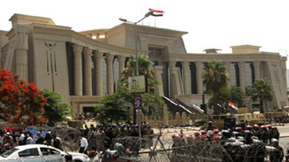 Hundreds of Islamists marched towards Egypt\'s Supreme Constitutional Court in Cairo last December. (AFP)