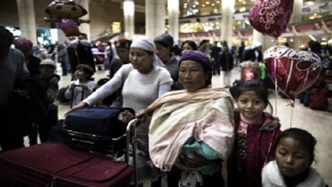 Jewish immigrants of the Bnei Menashe tribe of the Jewish community in Manipur, northeast India, wait to be reunited with family members as they arrive at Ben Gurion airport near Tel Aviv on December 24, 2012. (AFP)