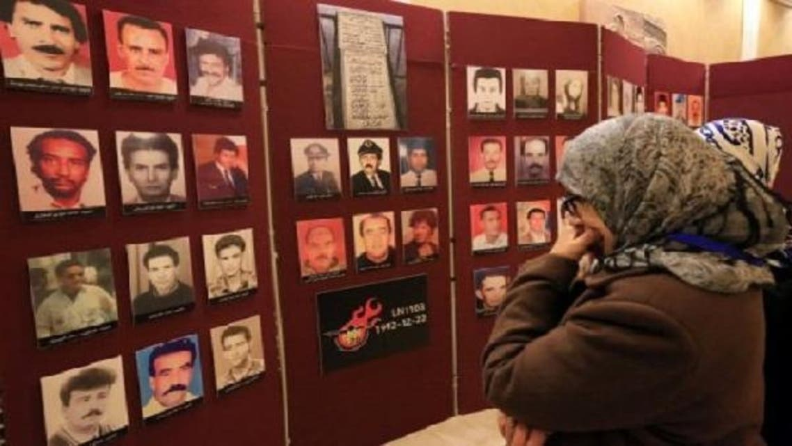 Women look at pictures of the 157 victims of flight LN 1103 at a memorial service in Tripoli on Dec. 22, 2012. (AFP)