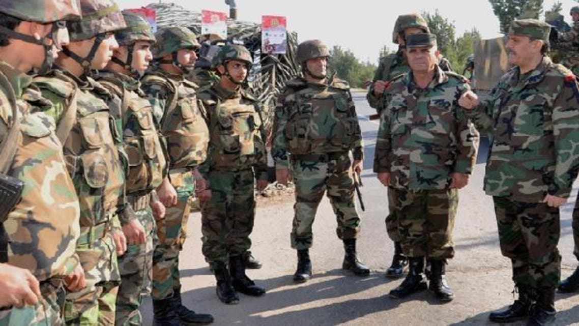 Syria's General Fahd Jassem al-Freij (R), Deputy Commander-in-Chief of the Army and the Armed Forces and Minister of Defense, accompanied by senior officers of the General Command, during an inspection of soldiers in Damascus. (AFP)