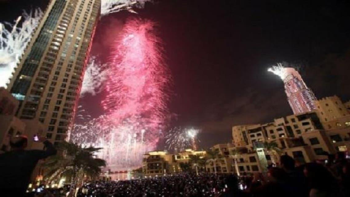 Fireworks illuminate Burj Khalifa at midnight in Dubai on Jan. 1, 2013. (AFP)