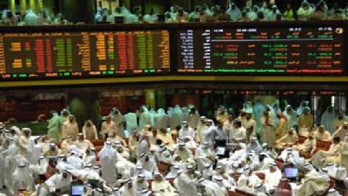 متداولون في سوق الكويت للأوراق المالية