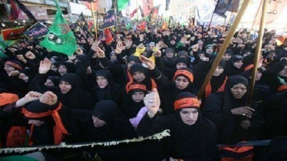 Shiite Muslim women attend the Arbaeen religious festival in Karbala, Iraq, on Thursday as car bomb killed at least 20 worshippers. (AFP)