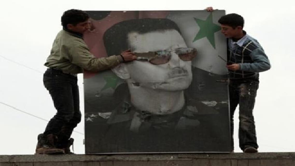 إحدى صور الأسد في قاعدة عسكرية  بشمال حلب