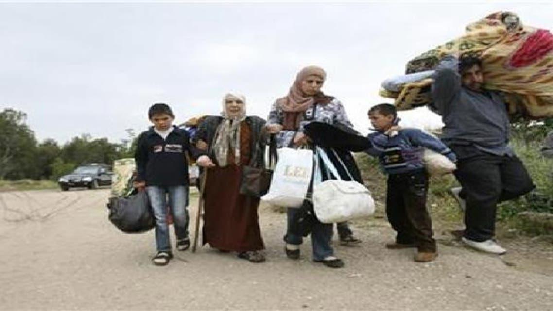 لبنان يطالب العالم بتقاسم أعباء اللاجئين السوريين