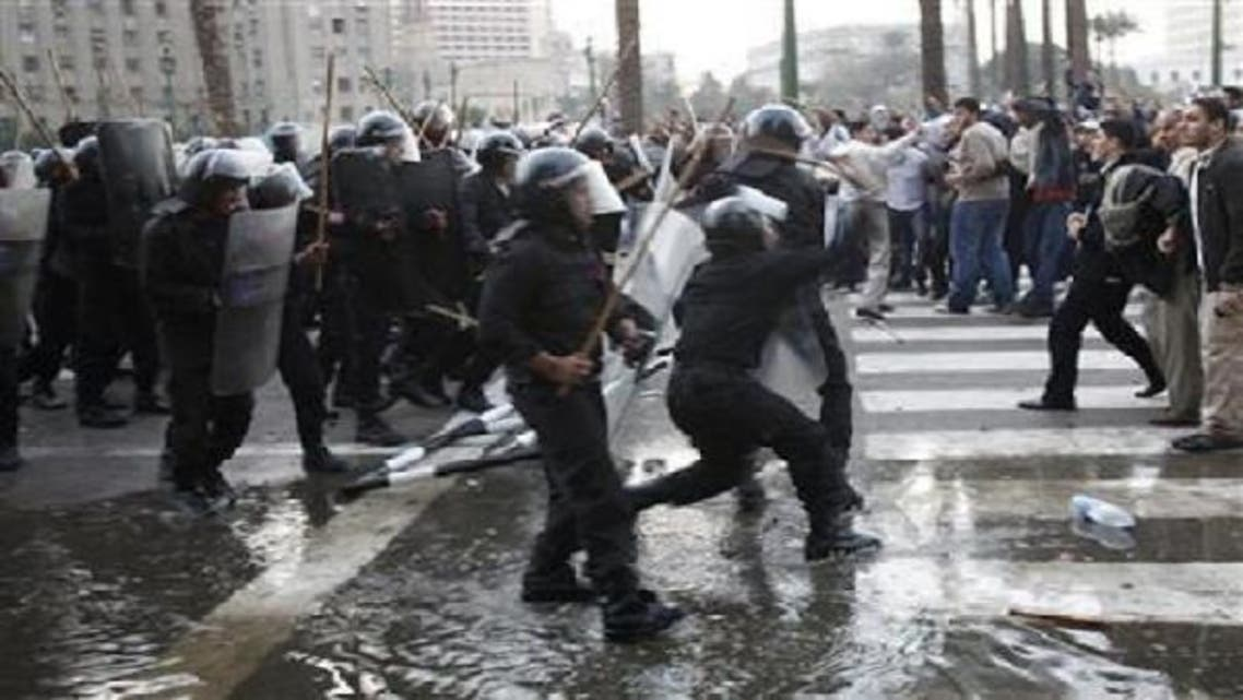 Anti-government protesters clash with police in downtown Cairo January 25, 2011. A new report reveals evidence against those accused of killing revolutionary protesters during Egypt's upheaval. (Reuters)