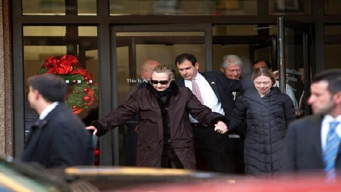 U.S. Secretary of State Hillary Clinton leaves New York Presbyterian Hospital with husband, Bill (top R) and daughter, Chelsea (R) in New York, January 2, 2013. (Reuters)