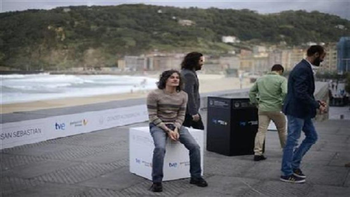 """(L-R) Director Ziad Doueiri and actors Karim Saleh, Ramzi Maqdisi and Ali Suliman attend a photocall following the screening of """"The Attack"""" on the fifth day of the San Sebastian Film Festival Sep. 25, 2012. (Reuters)"""