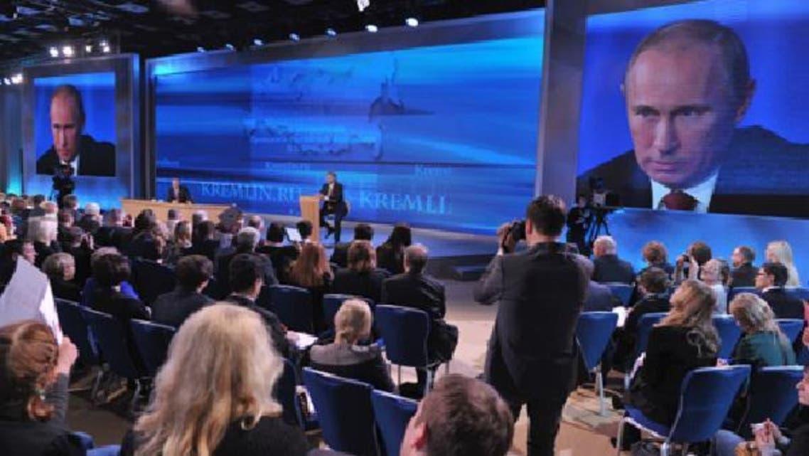 روسی صدر ولادی میر پوتین ماسکو میں سالانہ نیوز کانفرنس سے خطاب کررہے ہیں۔