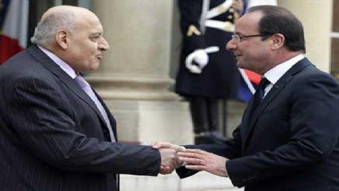 الرئيس الفرنسي مستقبلاً سفير الائتلاف السوري منذر ماخوص في 17 نوفمبر