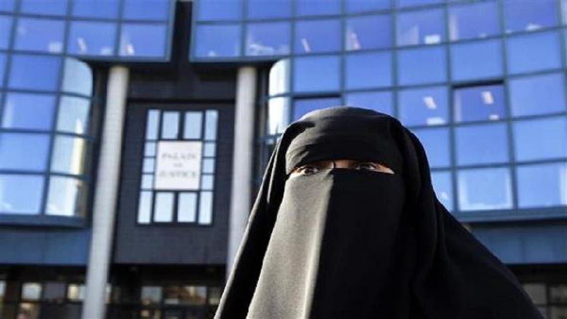 In France, Hind Ahmas wears a niqab despite a nationwide ban on the Islamic face veil outside the courts where she arrived with the intention to pay a fine after she was arrested last May for wearing the niqab in public, in Meaux, east of Paris, Sep. 22, 2011. (Reuters)