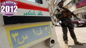 Iraq in 2012 scrambles for hope amid political spats violence