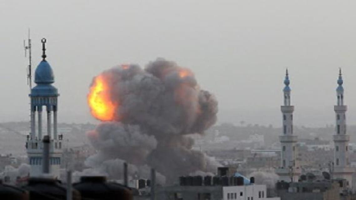 A fire ball rises as the Israeli air force carries out a raid over Gaza City on Nov. 17, 2012, for the fourth consecutive day. (AFP)
