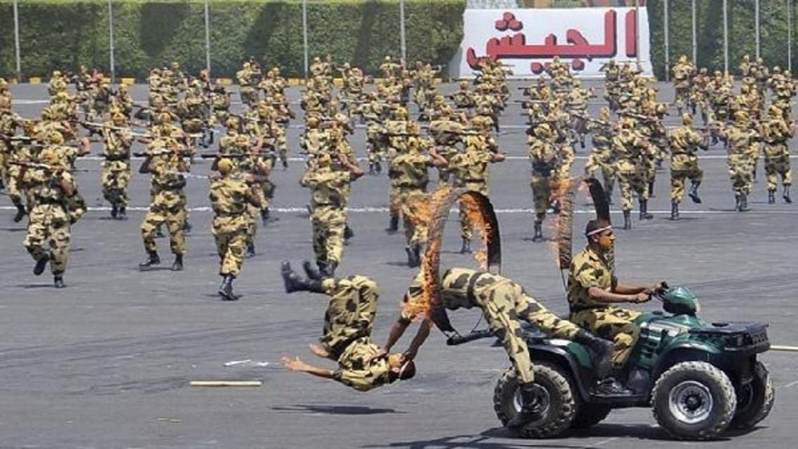 Soldiers perform during a medal ceremony for graduates at the Egyptian Military Academy in Cairo. (Reuters)