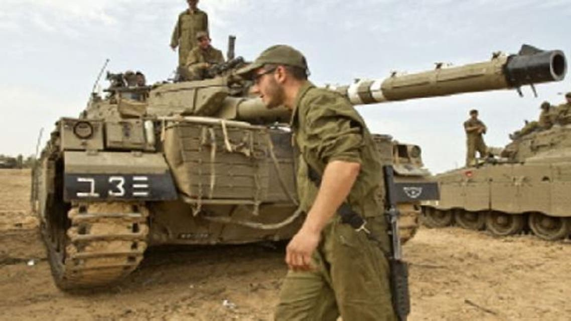 Israeli soldiers take position on the Israeli side of the border with the Gaza Strip on Nov. 17, 2012. (AFP)