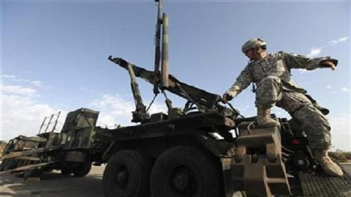 A U.S. Army officer stands on a launcher for a Patriot missile interceptor during a joint Israeli-U.S. air-defense exercise in Tel Aviv October 2009. (Reuters)