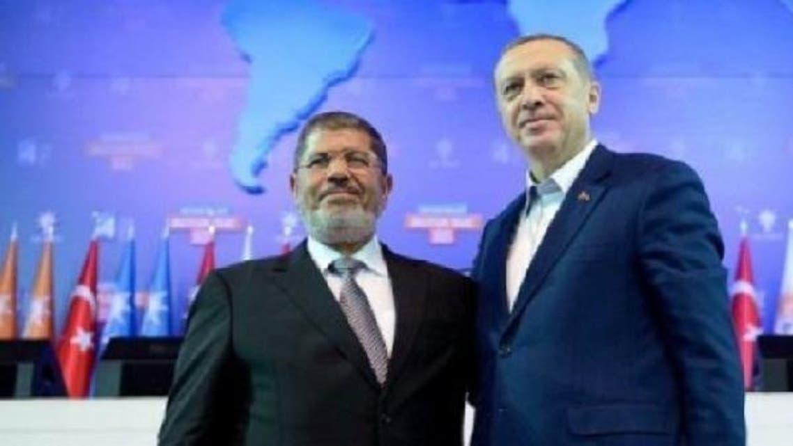 Turkey's Prime Minister Recep Tayyip Erdogan (R) and Egypt's President Mohamed Mursi on an earlier meeting in Ankara on Sept. 30, 2012.  (AFP)