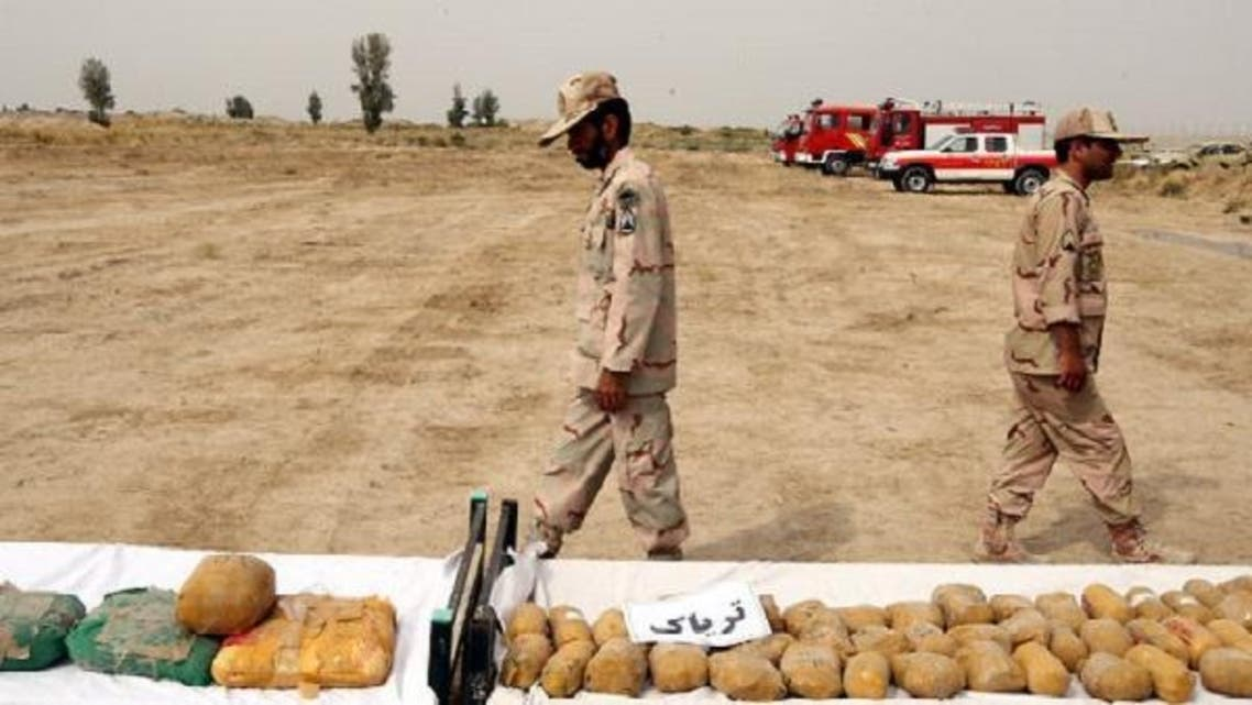 Iranian border guards display the packages of seized Afghan-made drugs at the Iran-Afghanistan border check point in Milak, south-eastern province of Sistan-Baluchestan, Iran, Oct.10, 2012. (EPA)