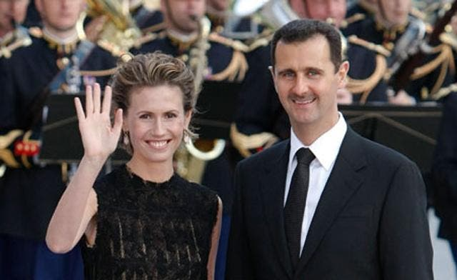 Embattled Syrian President Bashar al-Assad and his wife, Asma.  Assad previously rejected Western and Arab countries' asylum offers. (Reuters)