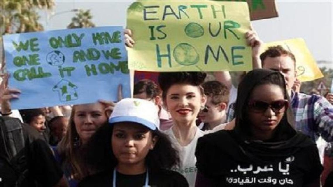 Activists march to demand action to address climate change in Doha on Dec. 1, 2012.(Reuters)