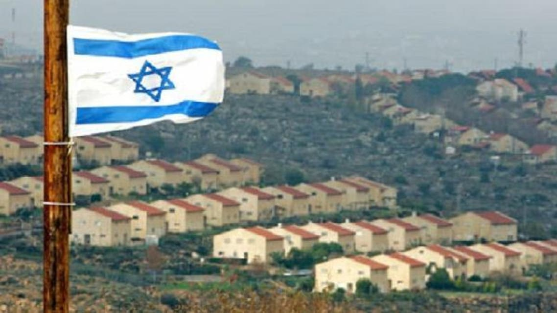 An Israeli flag over a view of the West Bank Jewish settlement of Ofra. (Reuters)