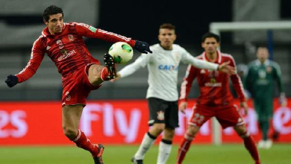 Egypt\'s Al Ahly defender Ramy Rabia (L) kicks the ball during their 2012 Club World Cup semi-final football match against Brazil\'s Corinthians in Toyota on Dec. 12, 2012. (AFP)