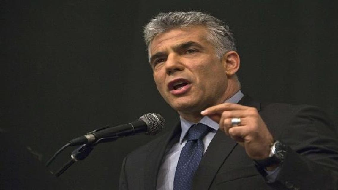 "Popular prime-time TV man Yair Lapid quit his job this year as weekend newsmagazine anchor and formed his own political party, Yesh Atid, or ""There is a Future."" (AFP)"