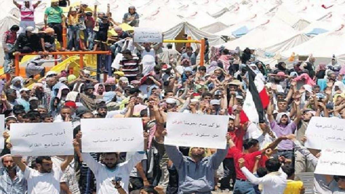 لاجئون سوريون يتظاهرون في مخيم هاتاي ضد نظام الأسد