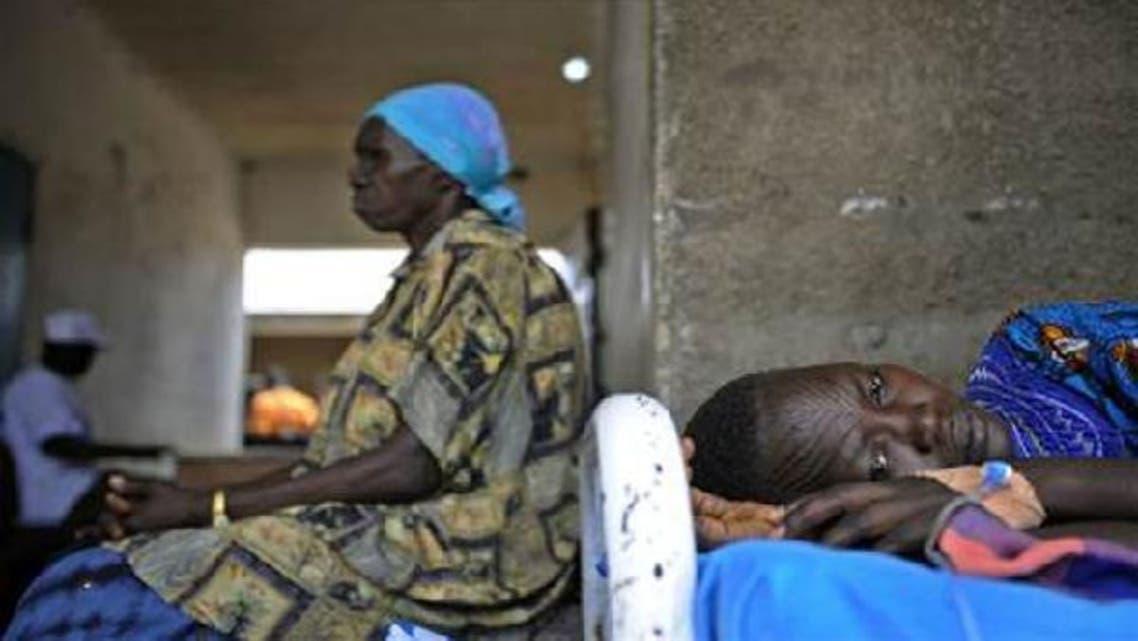 Sudanese women lie in a health clinic. (AFP)