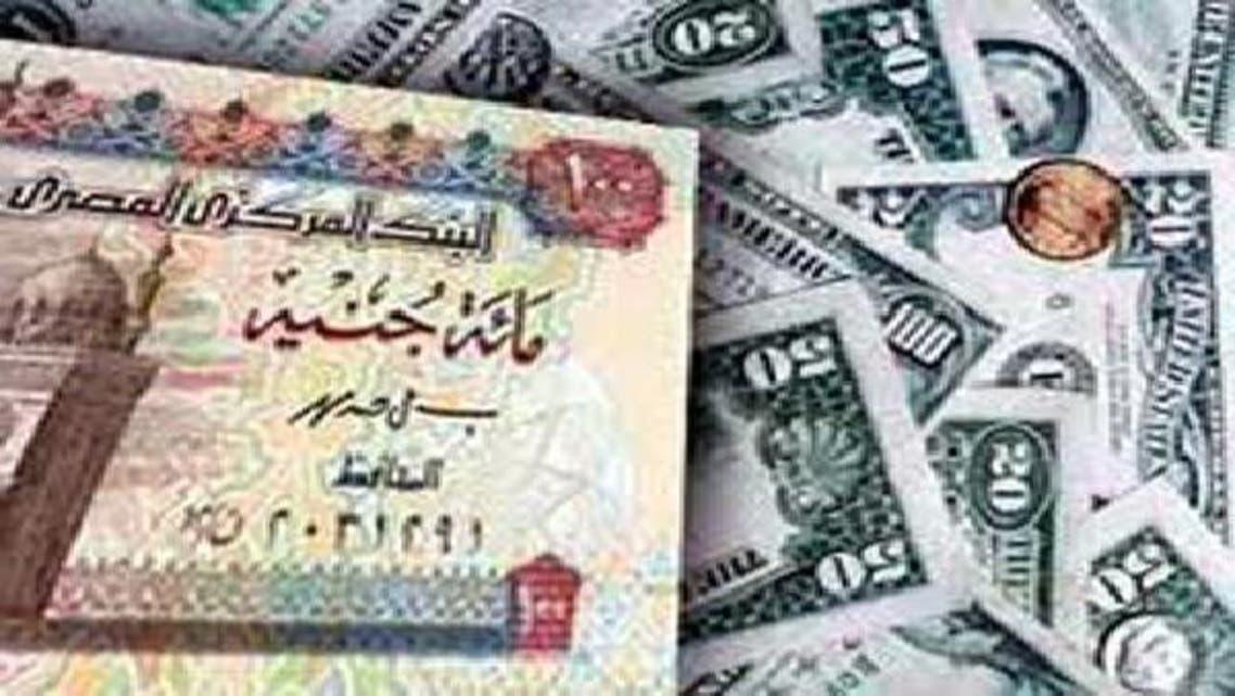عملة مصر تهوي لأدنى مستوى في 8 سنوات أمام الدولار