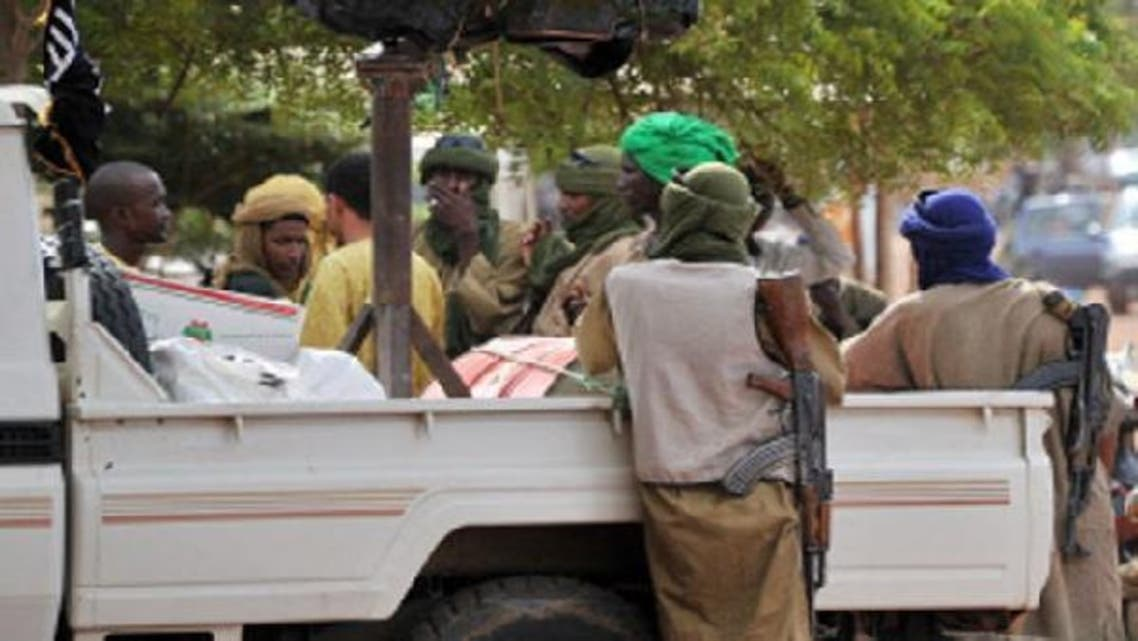 A file photo taken on September 21, 2012 shows a group of armed Islamists gathered in Gao, the biggest city in northern Mali now under the control of armed Islamist groups. (AFP)