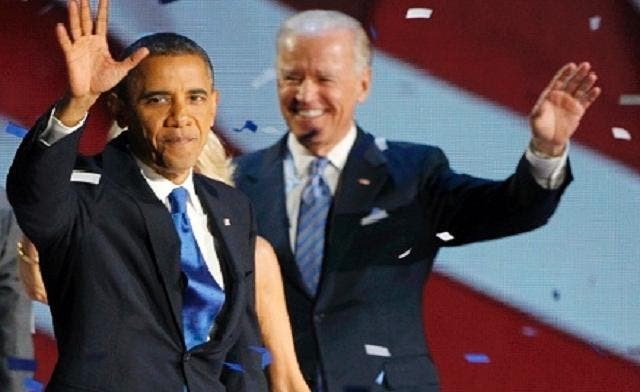U.S. President Barack Obama and Vice President Joe Biden (R) celebrate at their election night victory rally in Chicago November 6, 2012. (Reuters)