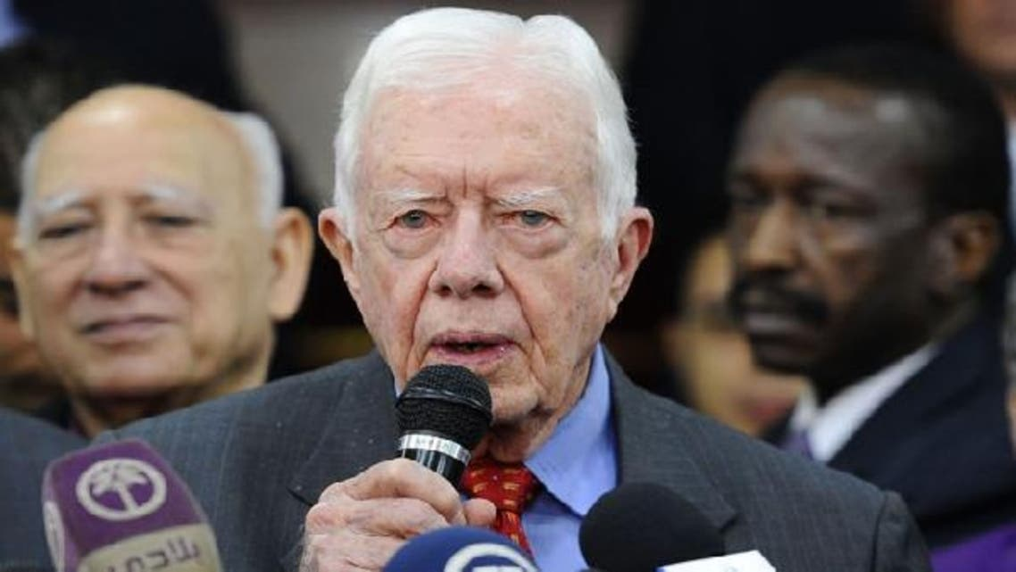 Former U.S. President Jimmy Carter speaks to reporters in Cairo. (Reuters)