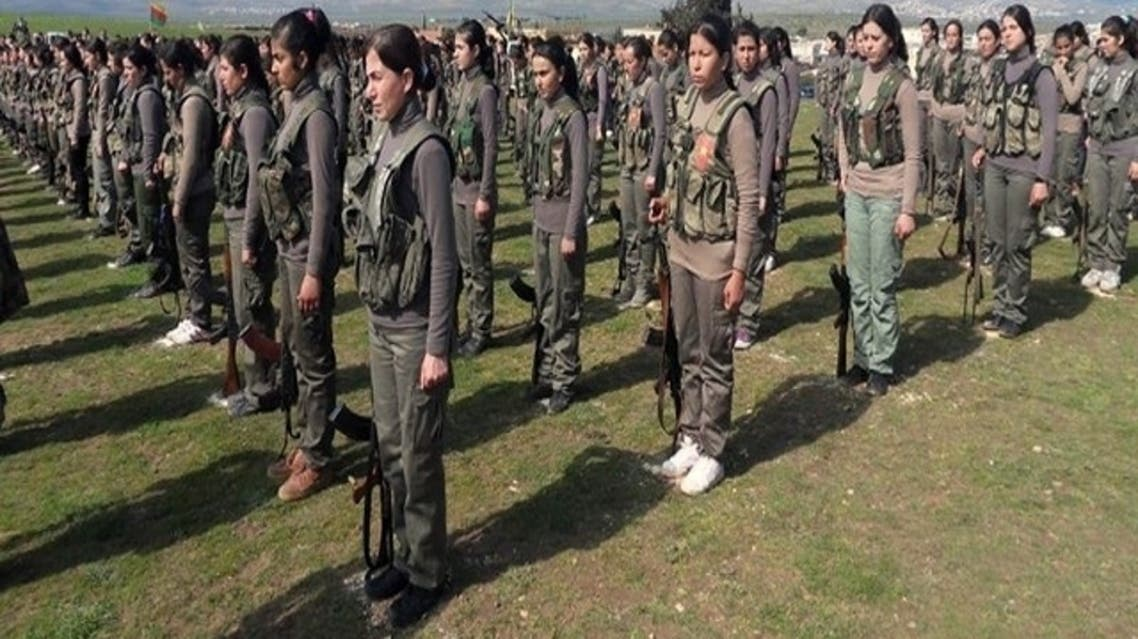 Syrian Observatory for Human Rights (SOHR) photograph of members of the first Kurdish female battalion named 'Martyr Rokan Battalion' lining up in military fatigues in the northwestern Syrian city of Afrin, on the Syria-Turkey border, on Feb. 22, 2013. (AFP)