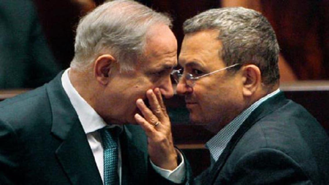 Israeli Prime Minister Benjamin Netanyahu (L) speaks with his Defence Minister Ehud Barak during a Knesset session. (Reuters)
