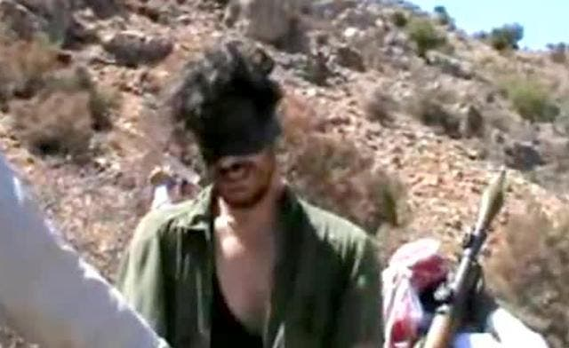 An image grab shows Austin Tice blindfolded with men believed to be his captors at an undisclosed location in Syria. (File Photo: AFP))