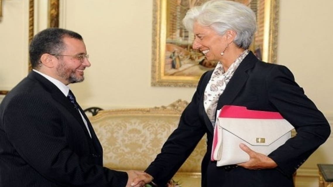 Prime Minister Hisham Qandil, right, and IMF chief Christine Lagarde. Egypt said it would re-open talks with IMF on a $4.8 billion loan. (AFP)