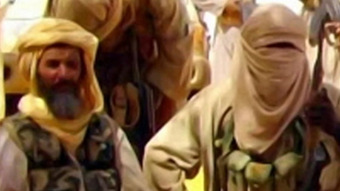This Al-Andalus image grab taken on September 30, 2010 from a video released today shows Abu Zeid (L), also known as Abid Hammadou, posing with fighters of al-Qaeda in the Islamic Maghreb (AQIM) and hostages (unseen) seized two weeks ago, among whom are five French. (AFP)