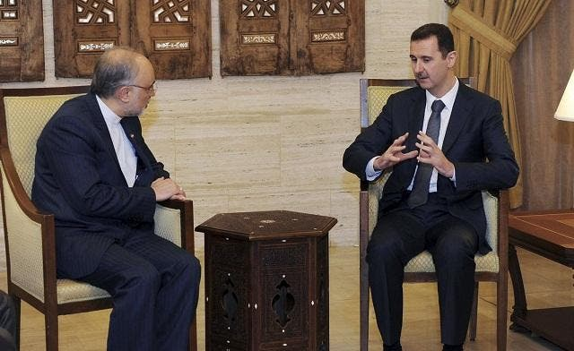 Syria's President Bashar al-Assad (R) meets Iran's Foreign Minister Ali Akbar Salehi in Damascus on Sept. 19, 2012. (Photo courtesy: SANA)