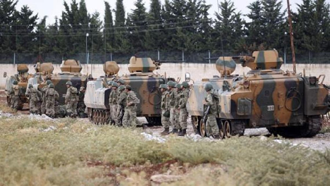 Turkey sent a convoy of about 20 vehicles carrying troops, missile batteries and armoured vehicles to the border with Syria. (Reuters)