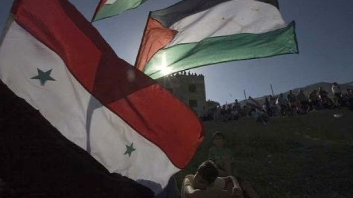 yarmuk palestinian refugee camp syria hanging death revolt