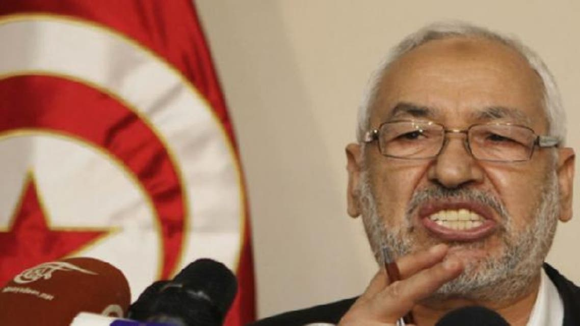 Tunisia's ruling Ennahda Movement leader Rachid Ghannouchi speaks during a news conference in Tunis. (Reuters)