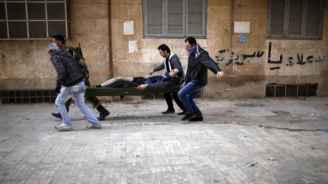 Civilians carrying out a wounded man on a stretcher after he was wounded by a sniper loyal to Syrian President Bashar el-Assad in Syria's north city of Aleppo. (Reuters)