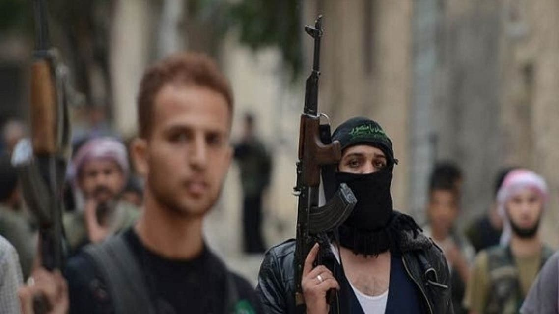 Syrian opposition fighters walk in the northern Syrian city of Aleppo on Oct. 11, 2012. (AFP)