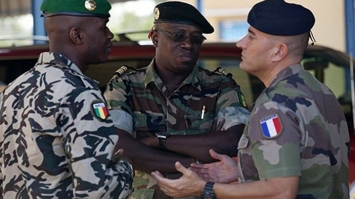 A French army officer, right, talks to his Malian and Senegalese army counterparts outside where a meeting is taking place for the intervention force provided by the ECOWAS grouping of West African states, in Bamako. (Reuters)