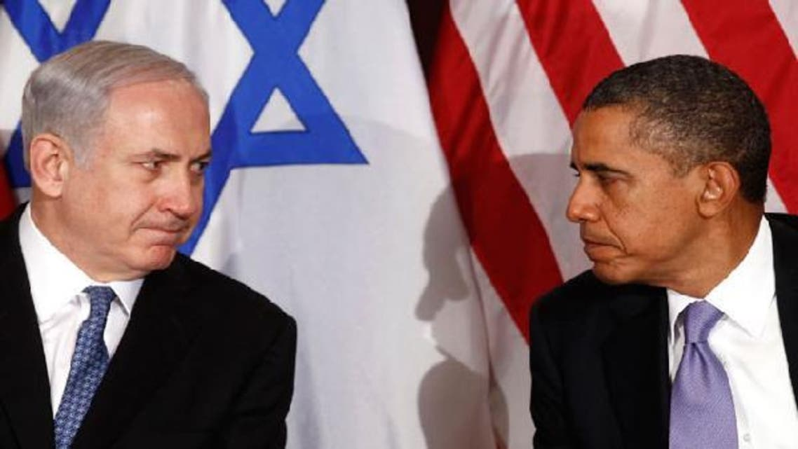 Israeli Prime Minister Benjamin Netanyahu (L) has been pushing U.S. President Barack Obama to adopt a tougher line against Iran. (Reuters)
