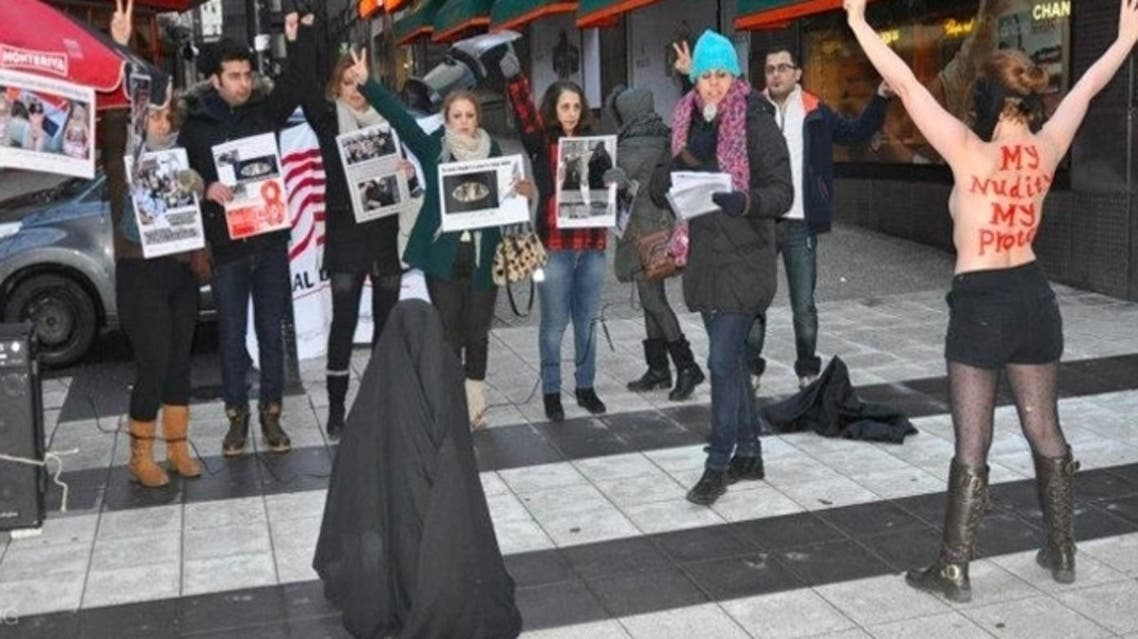 Members of the Iranian Communist Party and the Organization Against Violence on Women in Iran dedicated their action to International Women's Day on March 8. (Photo courtesy of femen.org)